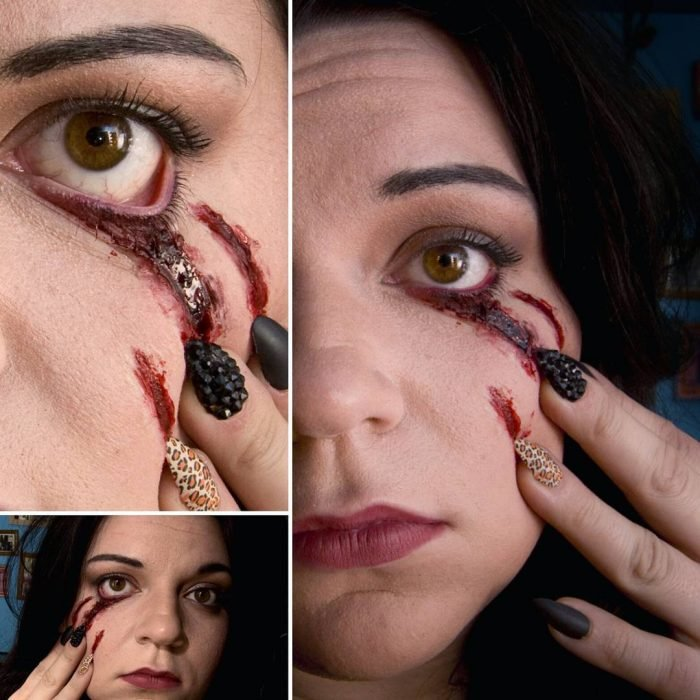 Chica aruñando su cara con las uñas