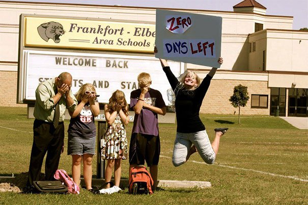Mom with a poster celebrating the return to classes