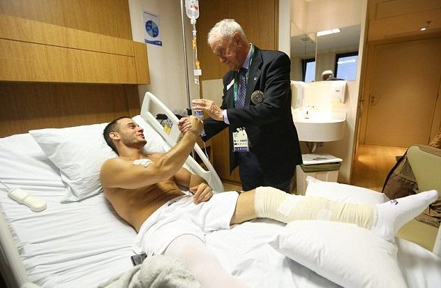 gimnasta francés fracturado y Bruno Grandi