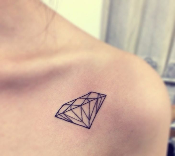 diamond tattoo on her shoulder