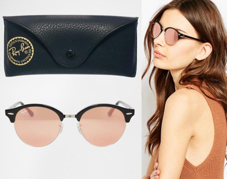 mujer blanca con lentes marca ray ban y estuche