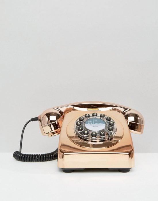 telefono antiugo de carrusel color rose gold