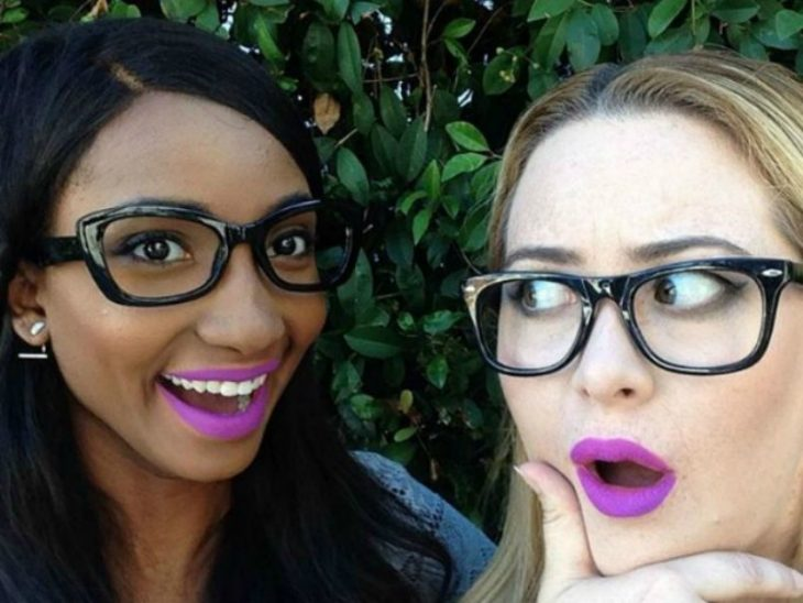 Two women with brown skin white and pink lipstick