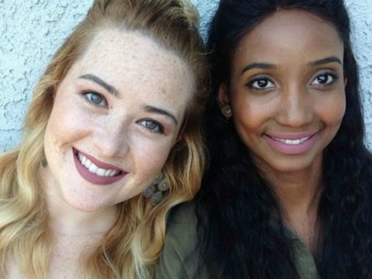 Two women with brown skin white and creamy pink lipstick