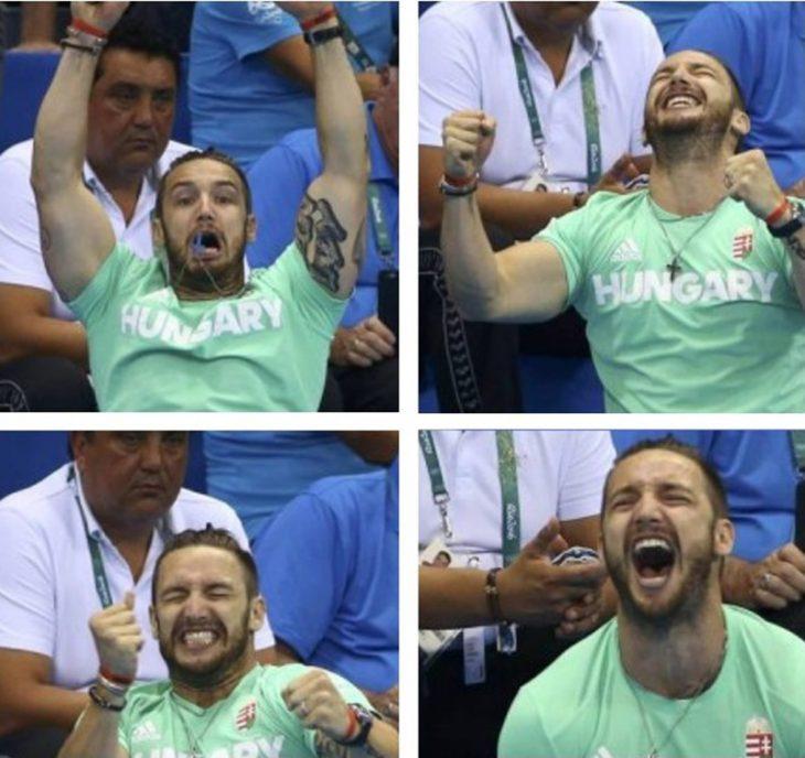 hombre de camisa verde y tatuaje levantando la manos y emocionado