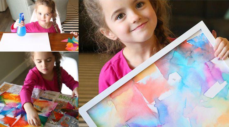 Niña haciendo una obra de arte con papel de colores.