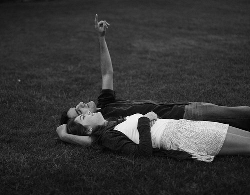 Couple lying under the stars.