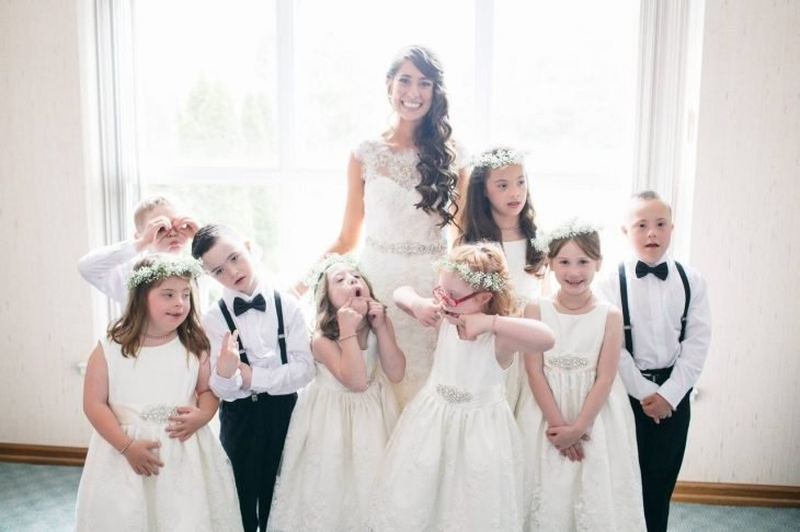 Woman with group of children dressed for a wedding