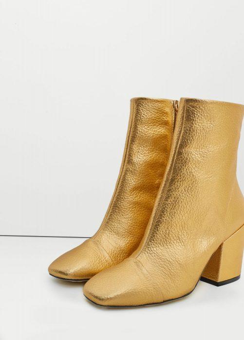 botas metálicas doradas