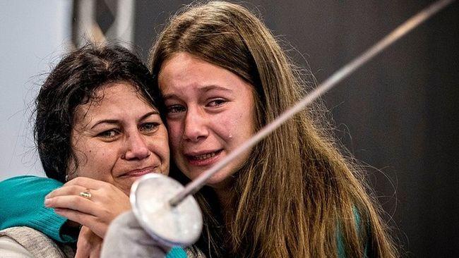 atleta paralímpica con su hija