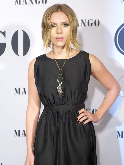 Scarlett Johanson with round neck dress and hair pulled.
