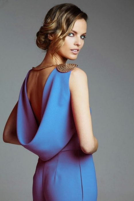 draping neckline and a tousled bun.