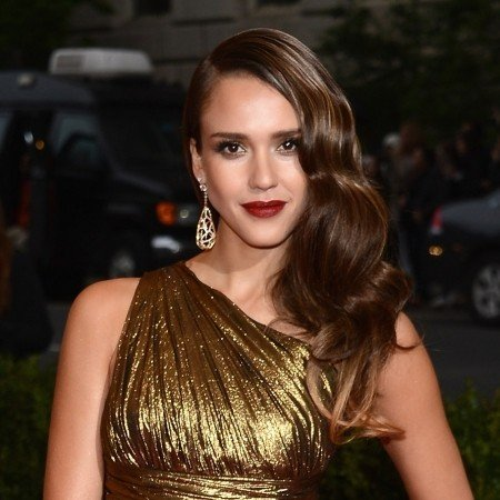 Jessica Alba with a hairstyle side to balance her cleavage.