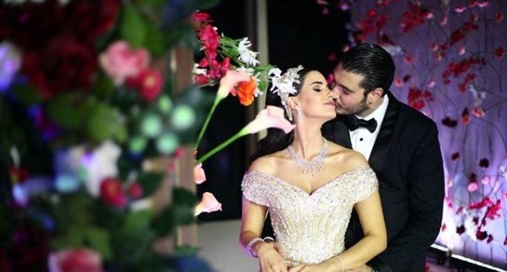 newlywed couple giving kiss