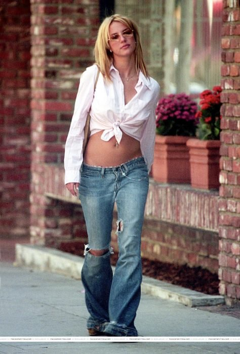 blonde woman with denim jeans hip