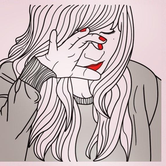 Chica limpiándose una lágrima.