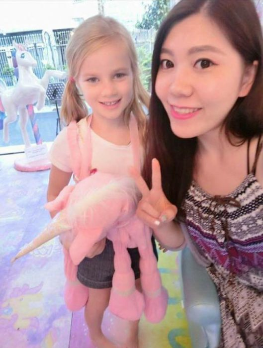 Girl with a unicorn in hand.