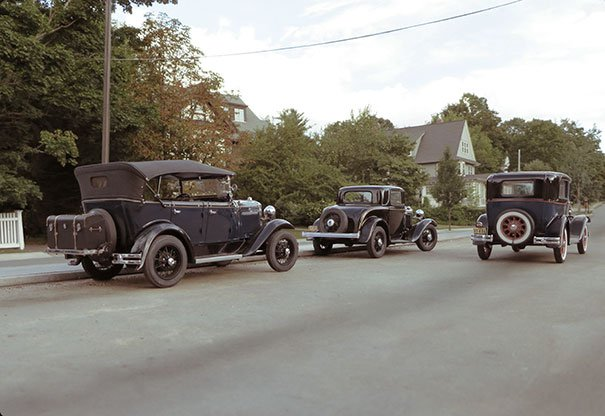 old cars in street