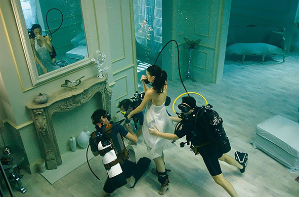 divers helping girl modeling for photo