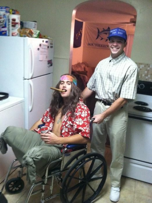 man wheelchair guy with long hair and cap