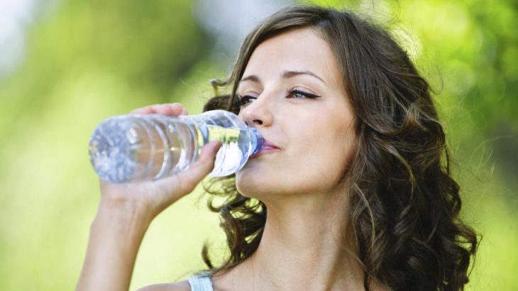 Woman drinking water.