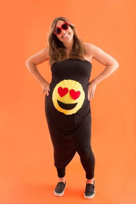 Pregnant woman dressed in black with emoji