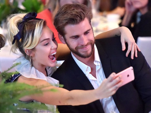 Liam and Miley drinking a selfie