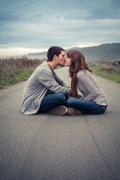 Kiss in the middle of the road.