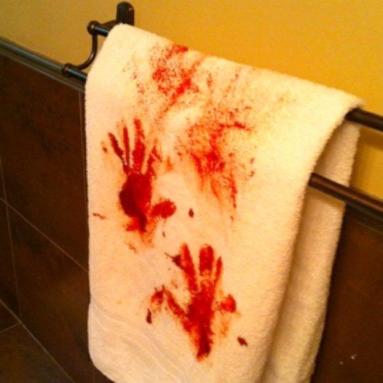 Towel with red painted hands.