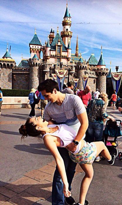 Couple outside Disneyland.