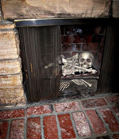 Bones of a skeleton in the fireplace.