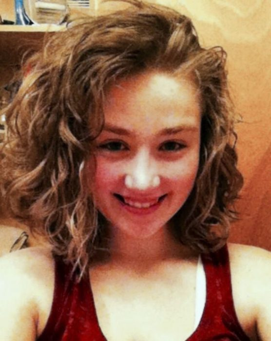 Curly-haired girl with bob cut.