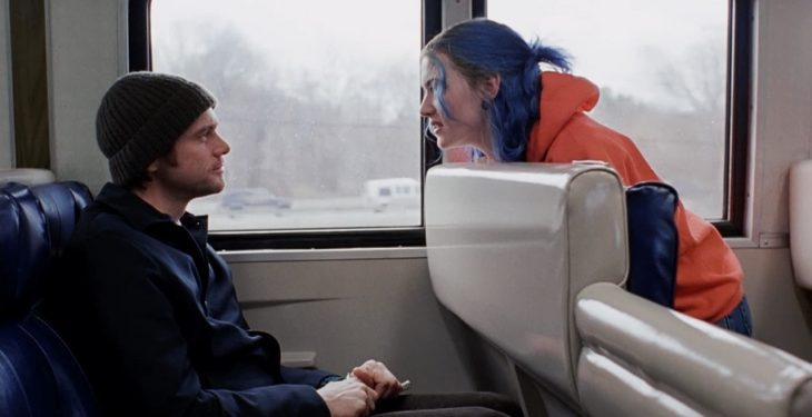 man talking to a woman on the train