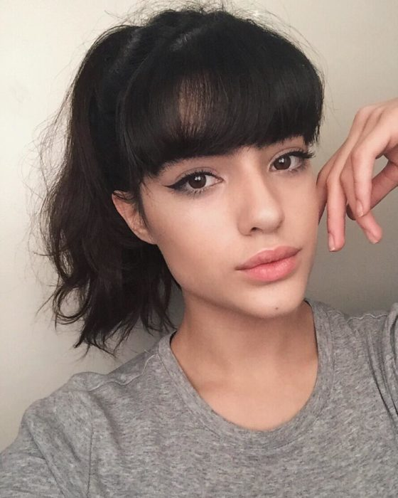 woman with bangs and ponytail