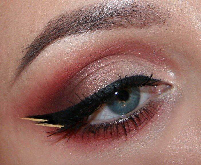 woman with colorful makeup and double outlined