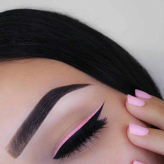 woman with makeup outlined pastel pink