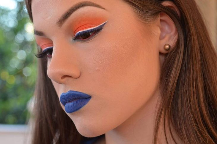 woman with orange makeup and blue lips