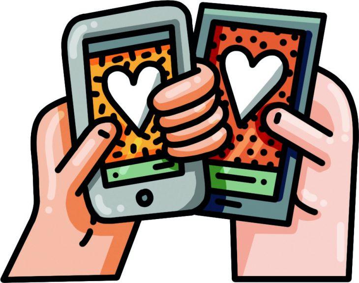 manos con celulares y corazones