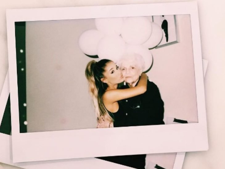 polaroid photo woman hugging her grandmother with balloons