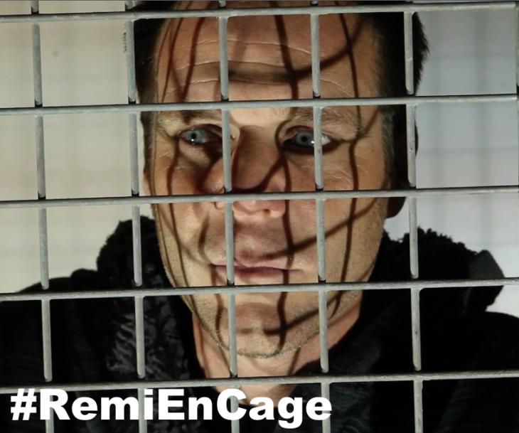 green-eyed man behind bars