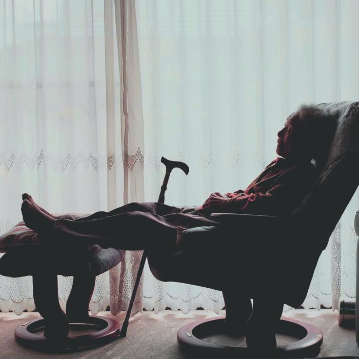 grandmother lying in an armchair