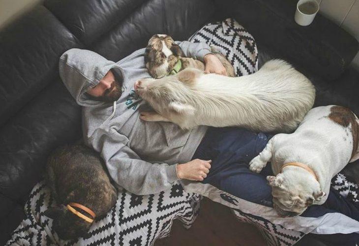 man lying next to a pig