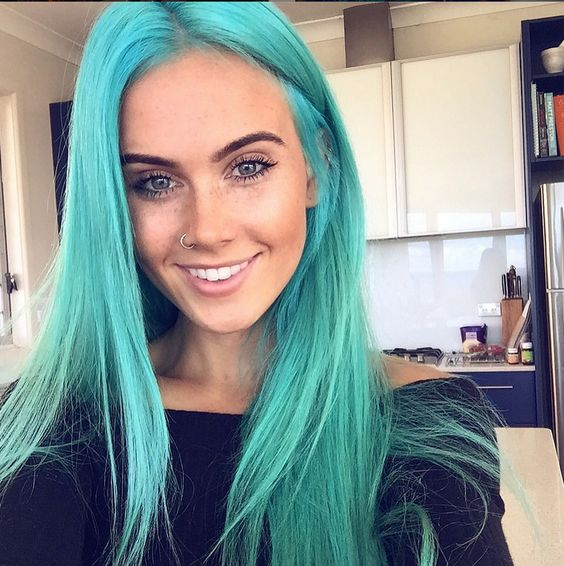 Girl with turquoise hair.