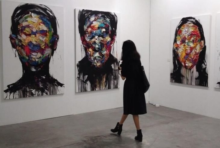 woman in a gallery with paintings