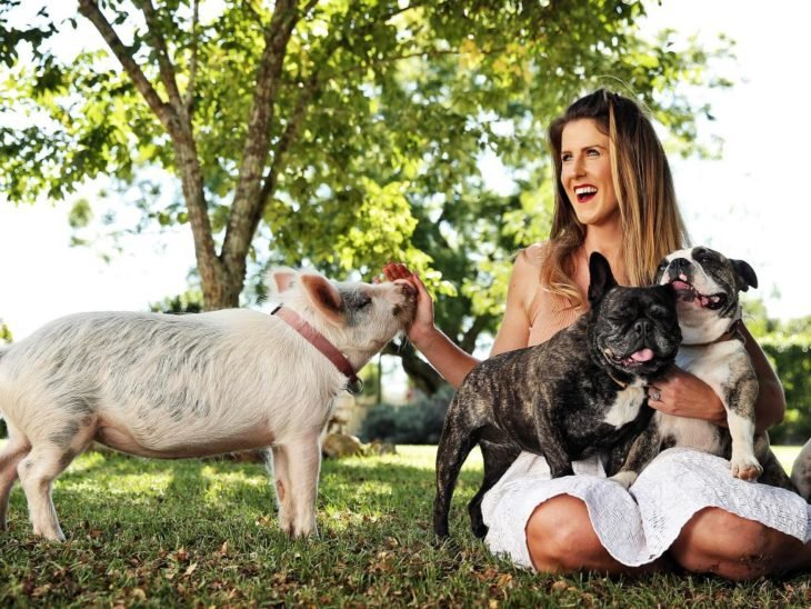 blonde woman with pork and dogs