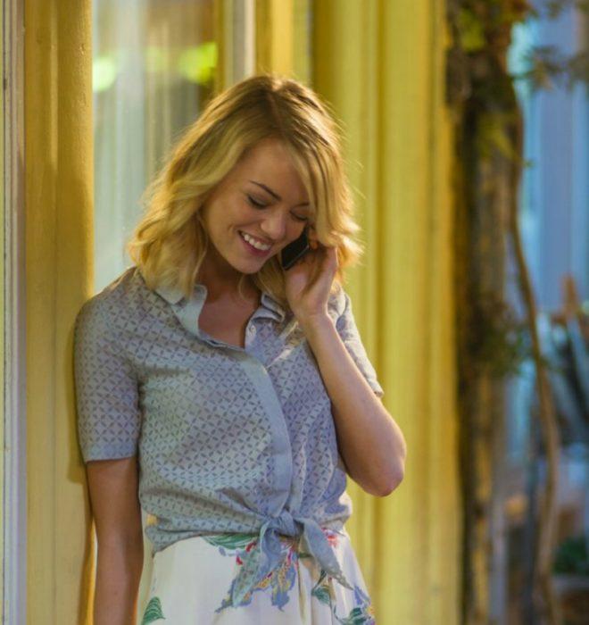 blonde woman talking on phone