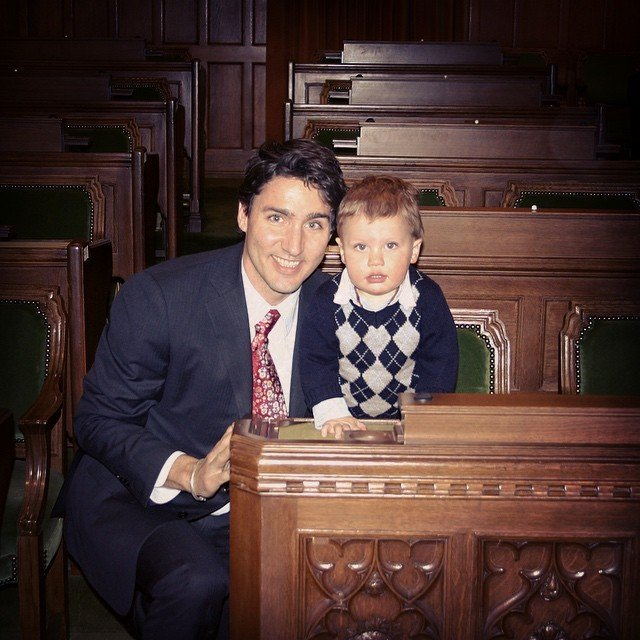 Justin Trudeau posing with a baby