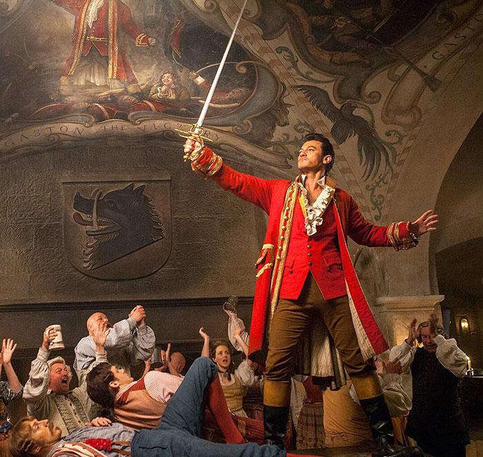 Gaston raising his sword.