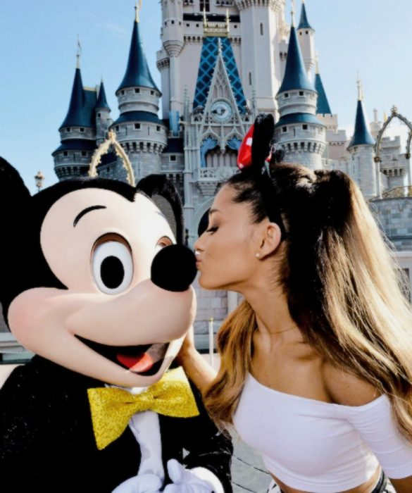 Girl kissing mickey mouse in disneyland