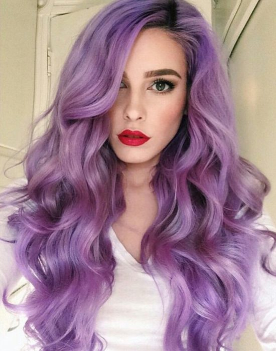 woman with purple hair and red lips